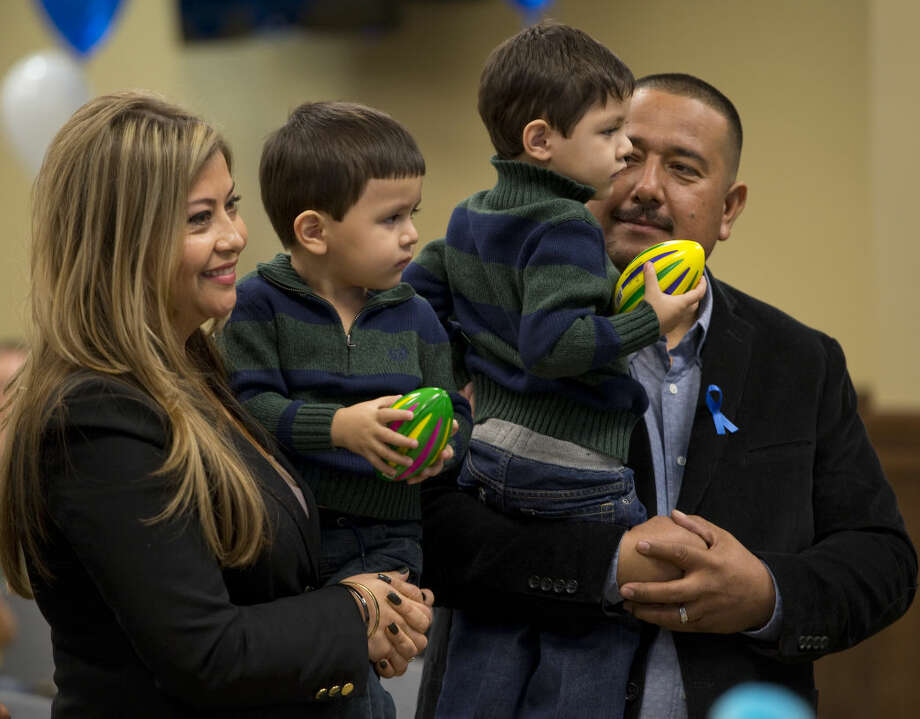 Ciria and Pedro Flores smile as the adoption of Allen and Angel is finalized Friday 11-20-2015 during a ceremony in front of Judge Sylvis Chavez on National Adoption Day. Tim Fischer\Reporter-Telegram Photo: Tim Fischer