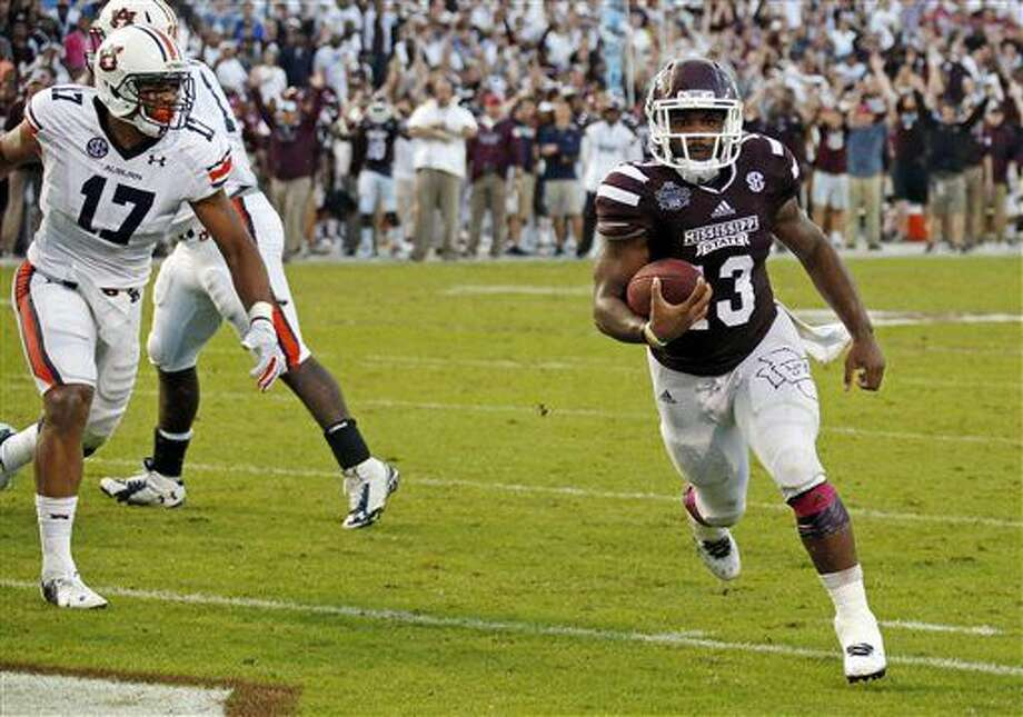 Mississippi State running back Josh Robinson (13) runs past Auburn linebacker Kris Frost (17) for a one yard touchdown run in the second half of their NCAA college football game in Starkville, Miss., Saturday, Oct 11, 2014. No. 3 Mississippi State beat No. 2 Auburn 38-23. (AP Photo/Rogelio V. Solis) Photo: Rogelio V. Solis