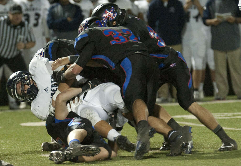 Argyle Liberty's Kyleb Howell gets wrapped up by gang of Midland Christian defenders Friday at Mustang Field. Tim Fischer\Reporter-Telegram Photo: Tim Fischer