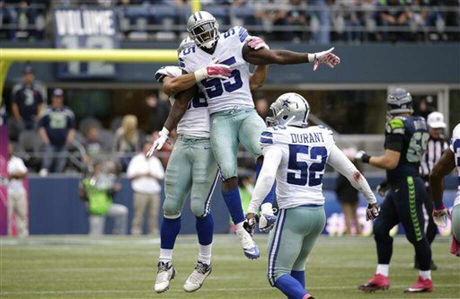 Dallas Cowboys middle linebacker Rolando McClain celebrates after he intercepted a pass late in the second half of an NFL football game against the Seattle Seahawks, Sunday, Oct. 12, 2014, in Seattle. The Cowboys beat the Seahawks 30-23. (AP Photo/Elaine Thompson) Photo: Elaine Thompson