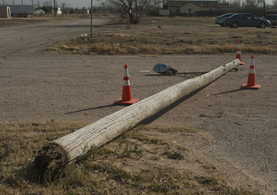 In this February 2013 file photo, Missouri Avenue was closed between Terrell and Dallas Street after a telephone poll was blown down by high winds. Tim Fischer\Reporter-Telegram Photo:  Tim Fischer\Reporter-Telegram