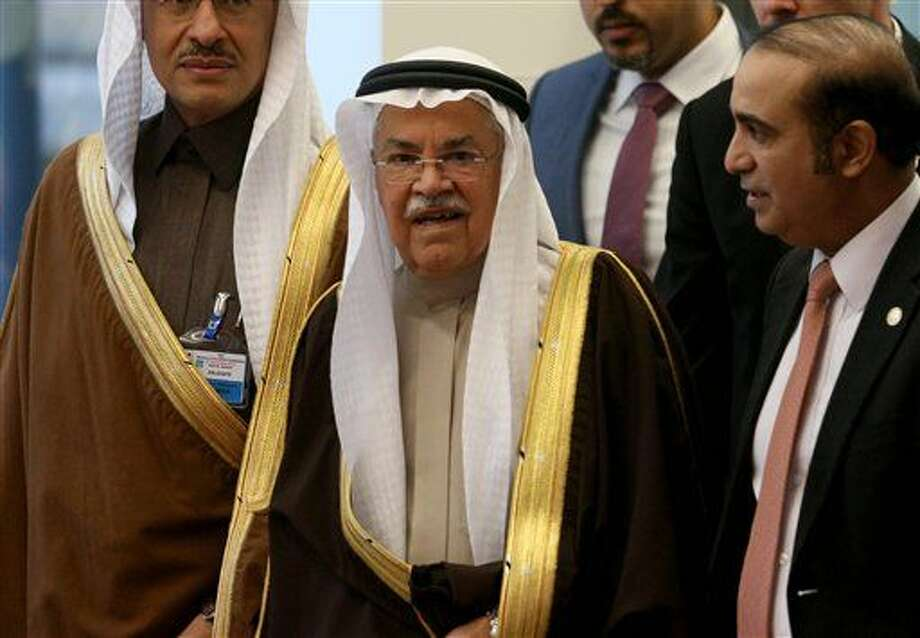 Saudi Arabia's Minister of Petroleum and Mineral Resources Ali Ibrahim Naimi arrives for a meeting of the Organization of the Petroleum Exporting Countries, OPEC, at their headquarters in Vienna, Austria, Friday, Dec. 4, 2015. (AP Photo/Ronald Zak) Photo: Ronald Zak