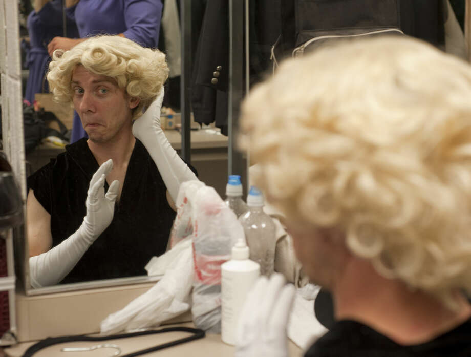 Ben Spencer checks his wig in a mirror as he gets readying for rehearsal in MCT's production of Leading Ladies. Photo: Tim Fischer\Reporter-Telegram
