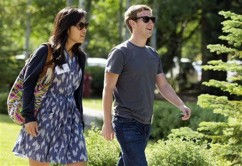 FILE - In this July 9, 2011 file photo, Facebook president and CEO Mark Zuckerberg, right, walks to morning sessions with Priscilla Chan during the Allen and Co. Sun Valley Conference, in Sun Valley, Idaho. Zuckerberg and his wife, Chan, are donating $25 million to the CDC Foundation to help address the Ebola epidemic, the foundation said Tuesday, Oct. 14, 2014. (AP Photo/Julie Jacobson, File) Photo: Julie Jacobson