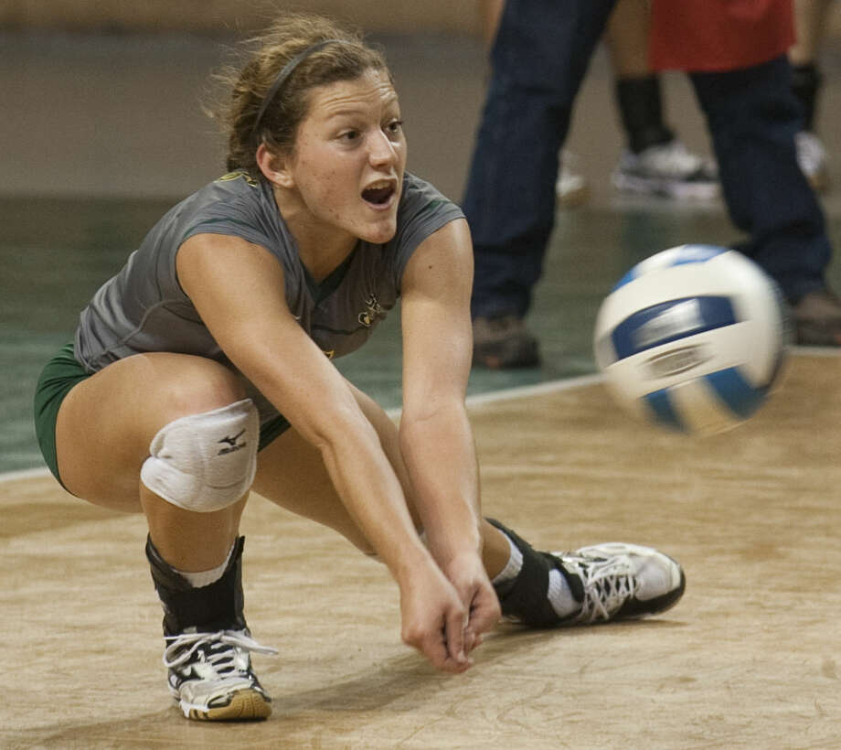 Midland College's DeeAnn Greehey gets low for a ball Wednesday against New Mexico Military Institute at the Chaparral Center. Tim Fischer\Reporter-Telegram Photo: Tim Fischer