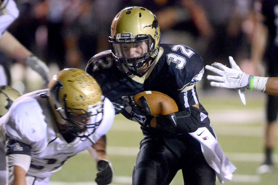 Big Spring running back Hunter Hill (32) runs against Andrews on Oct. 3 at Memorial Stadium in Big Spring. James Durbin/Reporter-Telegram Photo: James Durbin