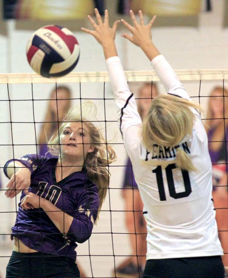 Midland High's Channing Burleson (10) gets a kill against Permian on Tuesday at MHS. James Durbin/Reporter-Telegram Photo: James Durbin