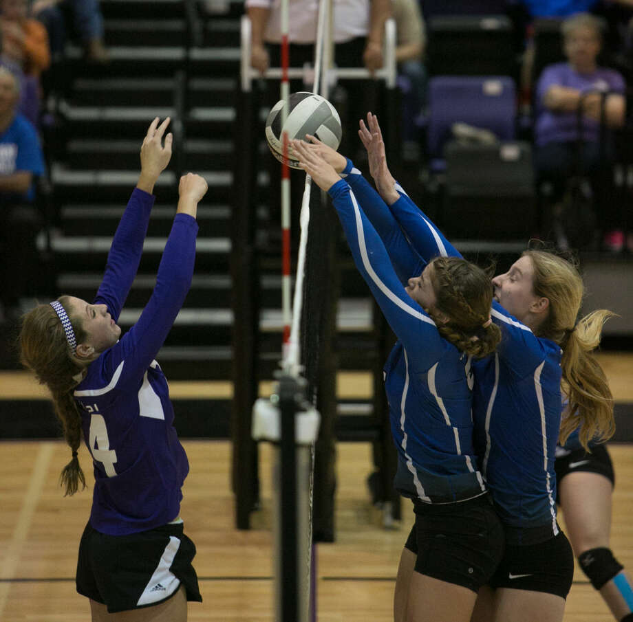 Midland Classical Academy's Alissa Beattie, left, tries hit while Trinity's Mady Walker and Ashley Stroup try to block on Tuesday during their TAPPS 1-3A match at Midland Classical Academy gymnasium. Claire Heck/Special to the MRT