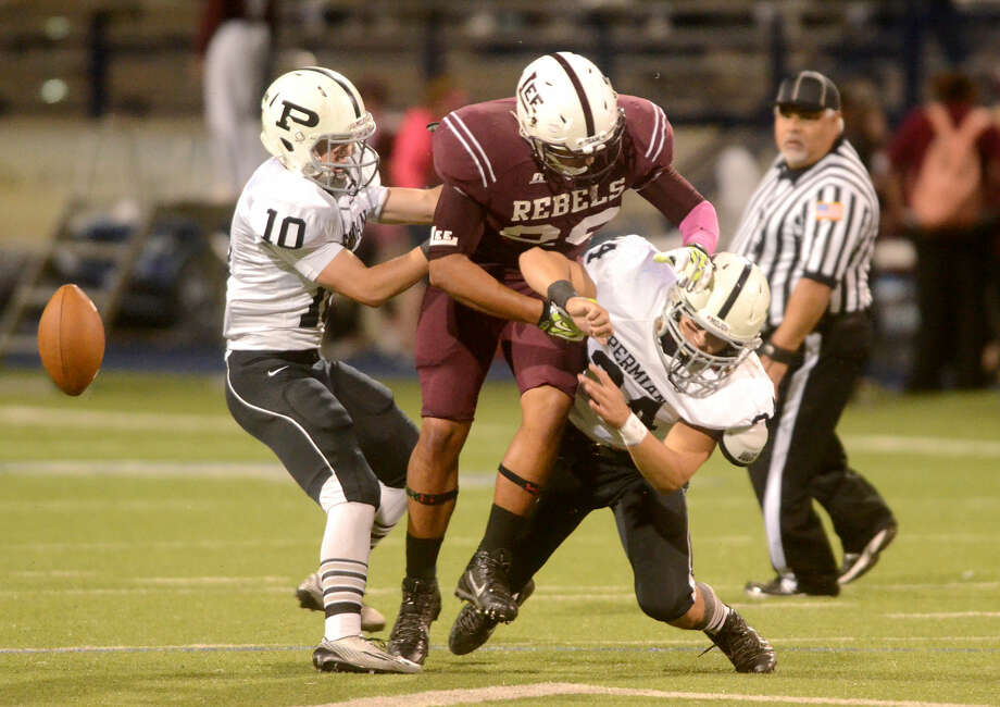 Lee High's Kaleb Nunez (26) gets a pass broken up by Permian's Jax Welch (10) and Joshua Nguyen (34) on Friday at Grande Communications Stadium. James Durbin/Reporter-Telegram Photo: James Durbin