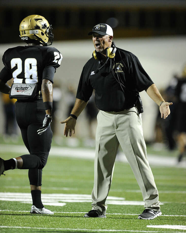 Abilene High head coach Steve Warren celebrates with running back Abram Smith (28) after a touchdown during the second quarter of the Eagles' 38-17 win in the Action Zone Champions Classic on Friday, Aug. 29, 2014, at Shotwell Stadium. (Photo by Tommy Metthe/Abilene Reporter-News) Photo: Thomas Metthe