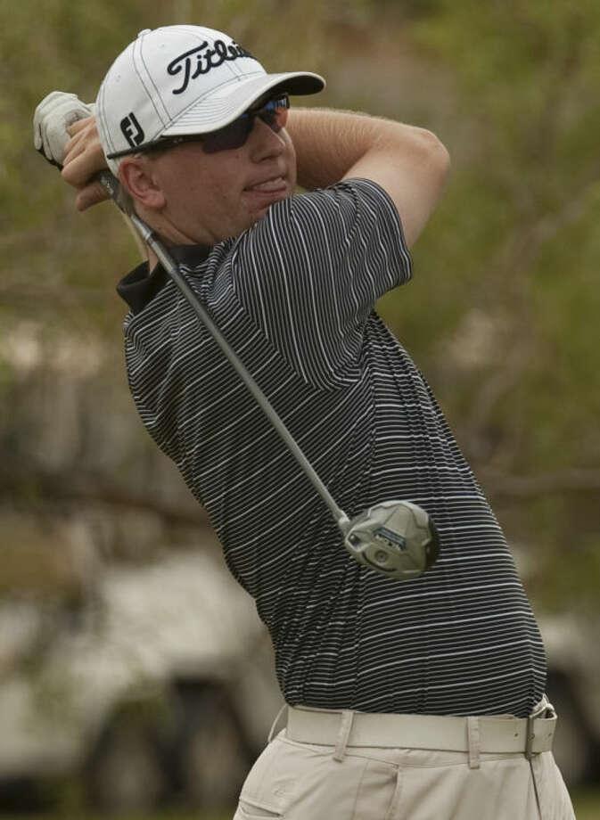 Lucas McCubbin follows his shot Saturday at Hogan Park Golf Course during the Midland Men's City Championship. Tim Fischer\Reporter-Telegram Photo: Tim Fischer