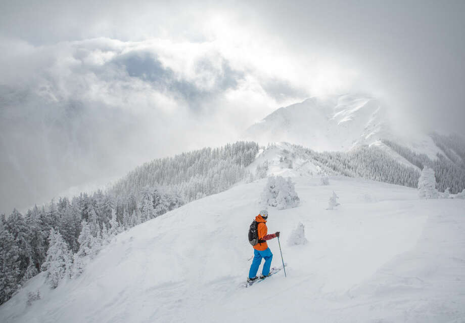 This undated photo provided by Taos Ski Valley shows a skier ascending Kachina Peak at the ski resort located in Taos, N.M. The El Nino weather pattern is expected to bring above-average snowfall to the state's ski resorts. Photo: Associated Press
