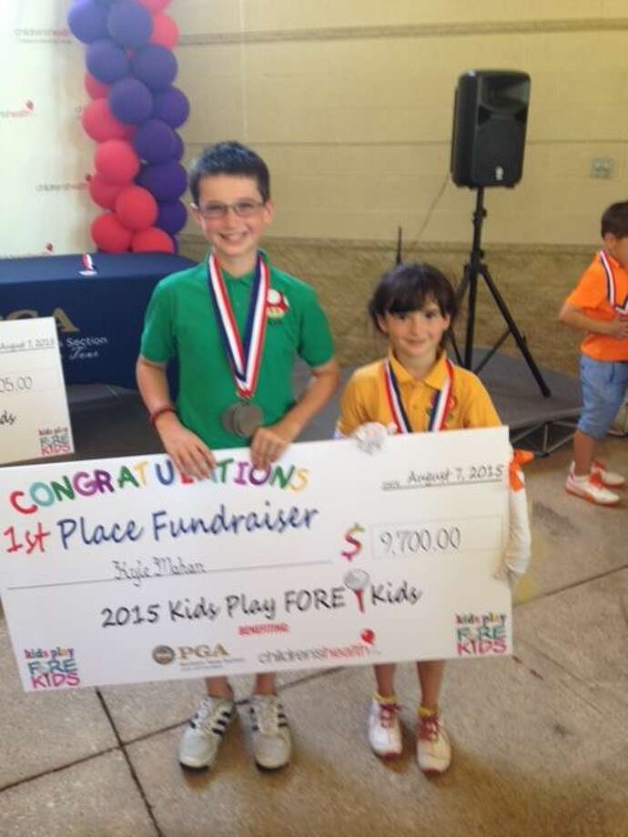 Kyle and Jules Mahan pose after winning a Kids Play Fore Kids fundraising event in August. Photo: Courtesy Photo