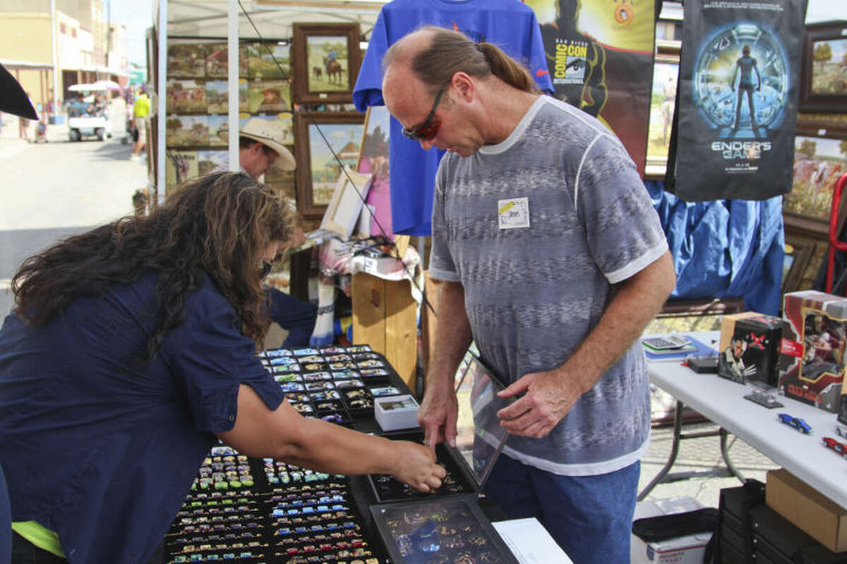 In this 2013 file photo, vendors and customers bargin for goods at the Old Sorehead Trade days in Stanton.