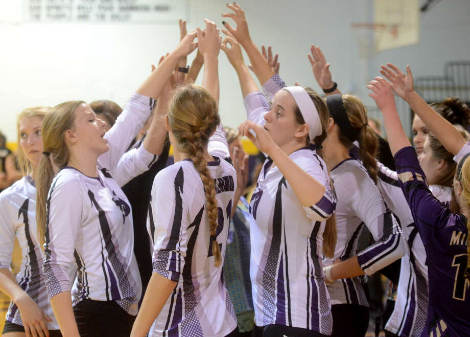 Midland High volleyball players huddle between matches against Abilene on Friday at MHS. James Durbin/Reporter-Telegram Photo: James Durbin