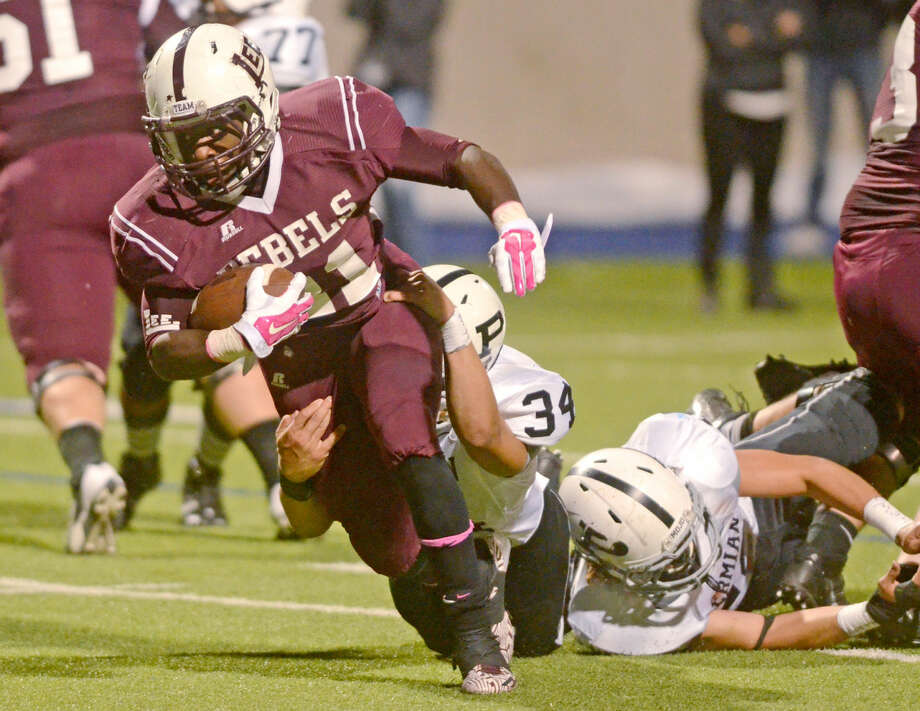 Lee High's Aron Dobbins (21) is brought down just shy of a touchdown by Permian's Joshua Nguyen (34) on Friday at Grande Communications Stadium. James Durbin/Reporter-Telegram Photo: James Durbin