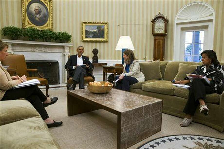 President Barack Obama meets with members of his public health and national security team about the response to the diagnosis of a second Ebola case in Dallas, Texas, Monday, Oct. 13, 2014, in the Oval Office of the White House in Washington. From left are, Lisa Monaco, Assistant to the President for Homeland Security and Counterterrorism, the president, Health and Human Services Secretary Sylvia Burwell, and National Security Adviser Susan Rice. (AP Photo/Jacquelyn Martin) Photo: Jacquelyn Martin