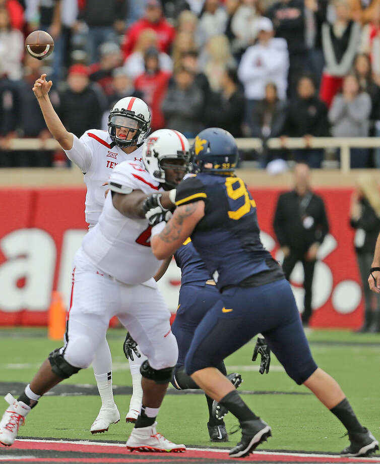 Tech quarterback Davis Webb releases a pass in Saturday's Big XII matchup with The West Virginia Mountaineers. Photo: Wade H Clay