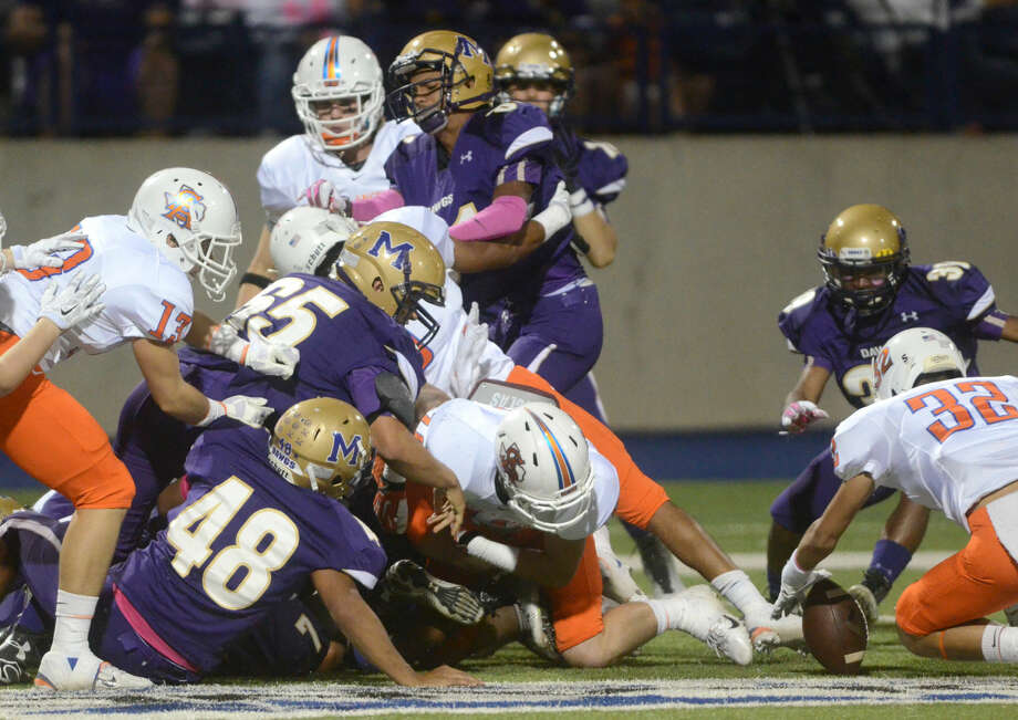 Members of the Midland High offense scramble to recover a fumble as San Angelo Central's Joseph Delgado (32) gets his hands on the ball on Friday at Midland High. James Durbin/Reporter-Telegram Photo: James Durbin