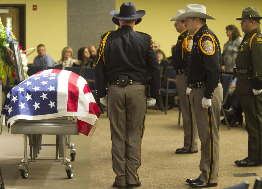 Members of the Honor Guard change shifts during the funeral ceremony for Midland County Sheriff's Dept. Sgt. Mike Naylor on Tuesday at Crestview Baptist Church. James Durbin/Reporter-Telegram Photo: James Durbin