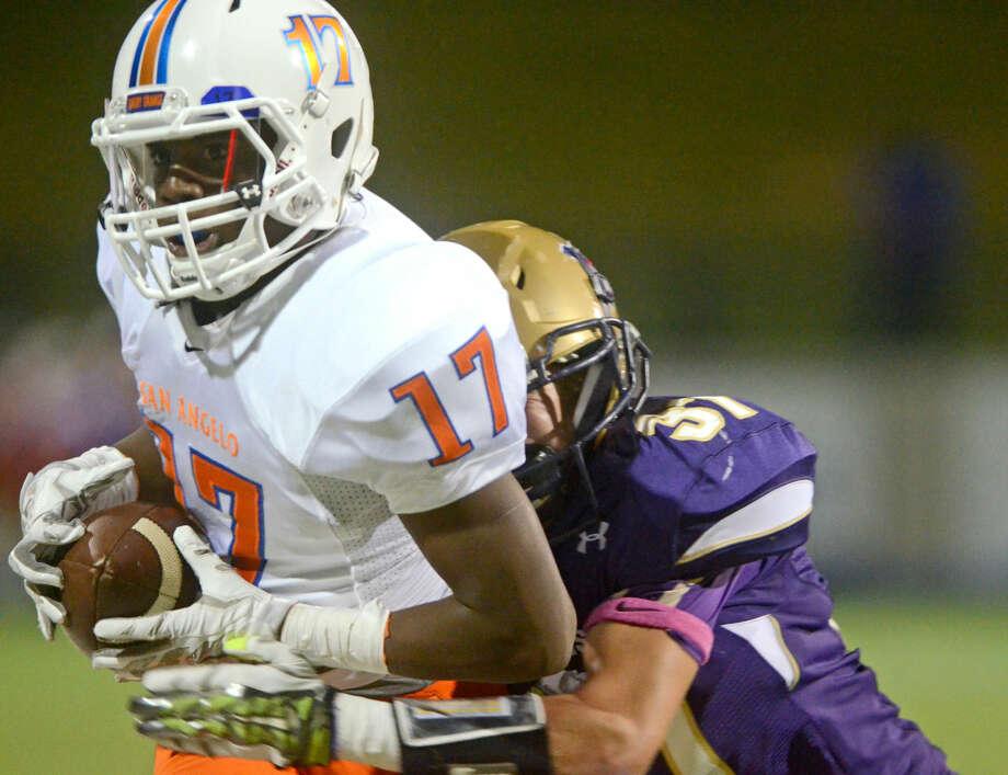Midland High's Blake Humble (37) tackles San Angelo Central wide receiver Kaczarick Ware (17) on Friday at Midland High. James Durbin/Reporter-Telegram Photo: James Durbin