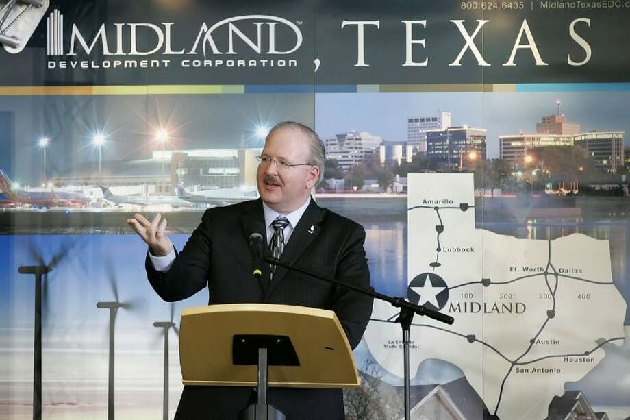 Jeff Greason, president and chief executive officer of XCOR Aerospace Inc., talks about the company's future in Midland Monday at Midland International Airport. Midland Development Corp. and Midland City Council voted unanimously to approve a $10 million incentive deal that would bring the headquarters of XCOR Aerospace Inc's rocket engine and space flight development company to Midland. Cindeka Nealy/Reporter-Telegram Photo: Cindeka Nealy