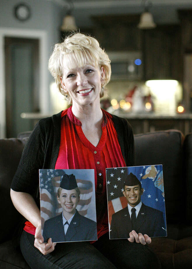 Stephanie Harper, a US Air Force veteran, poses with pictures of her son and daughter who are also veterans of the USAF, on Friday, Dec. 4, 2015, at her home in west Midland. James Durbin/Reporter-Telegram Photo: James Durbin