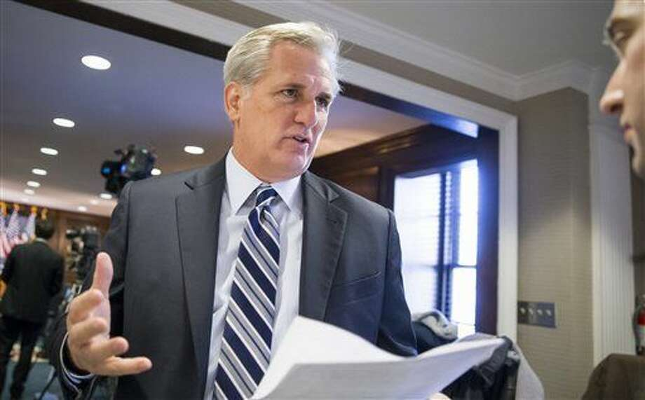 "Majority Leader Kevin McCarthy, R-Calif., speaks with a reporter following a closed-door GOP caucus meeting at the Republican National Headquarters on Capitol Hill in Washington, Tuesday, Dec. 8, 2015. Invoking the Paris terror attacks, House lawmakers pushed toward a vote Tuesday on legislation tightening controls on travel to the U.S. and requiring visas for anyone who's been in Iraq or Syria in the previous five years. ""You have more than 5,000 individuals that have Western passports in this program that have gone to Iraq or Syria in the last five years,"" said McCarthy. ""Those are gaps that we need to fix."" (AP Photo/J. Scott Applewhite) Photo: J. Scott Applewhite"