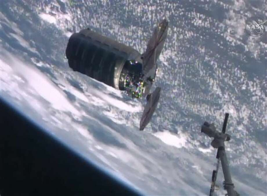 In this frame grab from video shown on NASA TV, the Cygnus supply ship approaches the robot arm of the International Space Station, in preparation for capture, early Wednesday, Dec. 9, 2015, delivering Christmas presents and much-needed groceries for the resident astronauts. (NASA TV via AP) Photo: HOGP