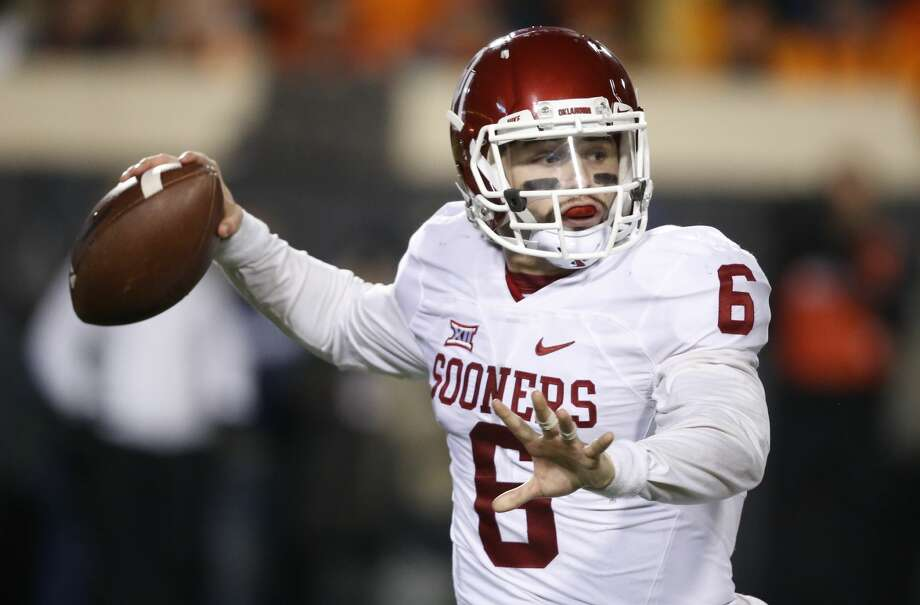 Oklahoma quarterback Baker Mayfield (6) passes in the second quarter of an NCAA college football game against Oklahoma State in Stillwater, Okla., Saturday, Nov. 28, 2015. (AP Photo/Sue Ogrocki)