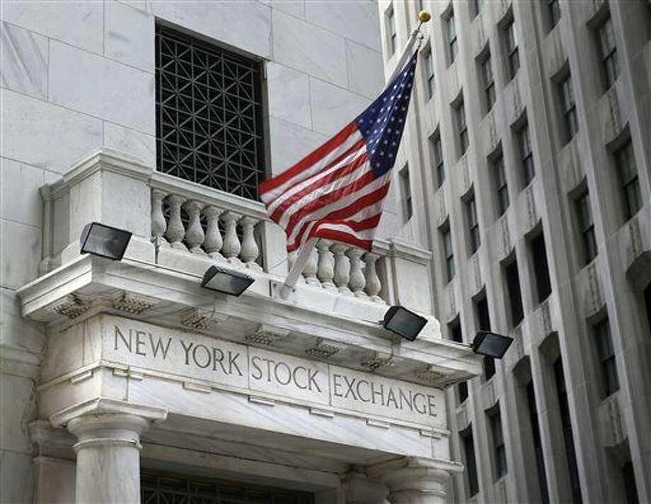 FILE - This Monday, Aug. 24, 2015, file photo, shows the New York Stock Exchange. U.S stocks fell in early trading Tuesday, Dec. 8, 2015, following a sell-off in Asia and Europe as the price of oil continued to slide to seven-year lows. The losses were broad, with all 10 industry sectors of the Standard and Poor's 500 index down. (AP Photo/Seth Wenig, File) Photo: Seth Wenig