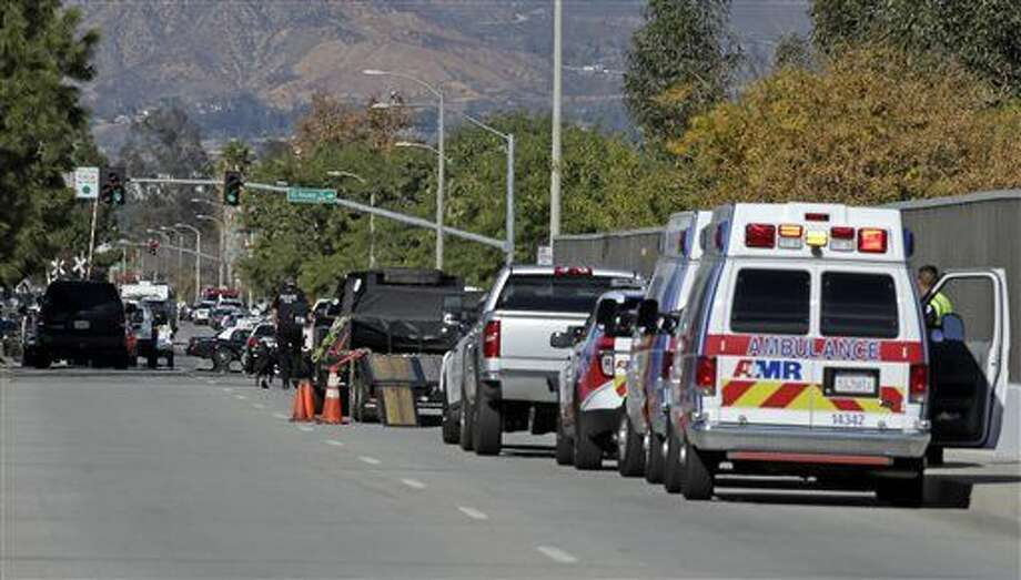 Law enforcement members line up near the the site of a mass shooting on Wednesday, Dec. 2, 2015 in San Bernardino, Calif. One or more gunmen opened fire Wednesday at a Southern California social services center, shooting several people as others locked themselves in their offices, desperately waiting to be rescued by police, witnesses and authorities said.(AP Photo/Chris Carlson) Photo: Chris Carlson