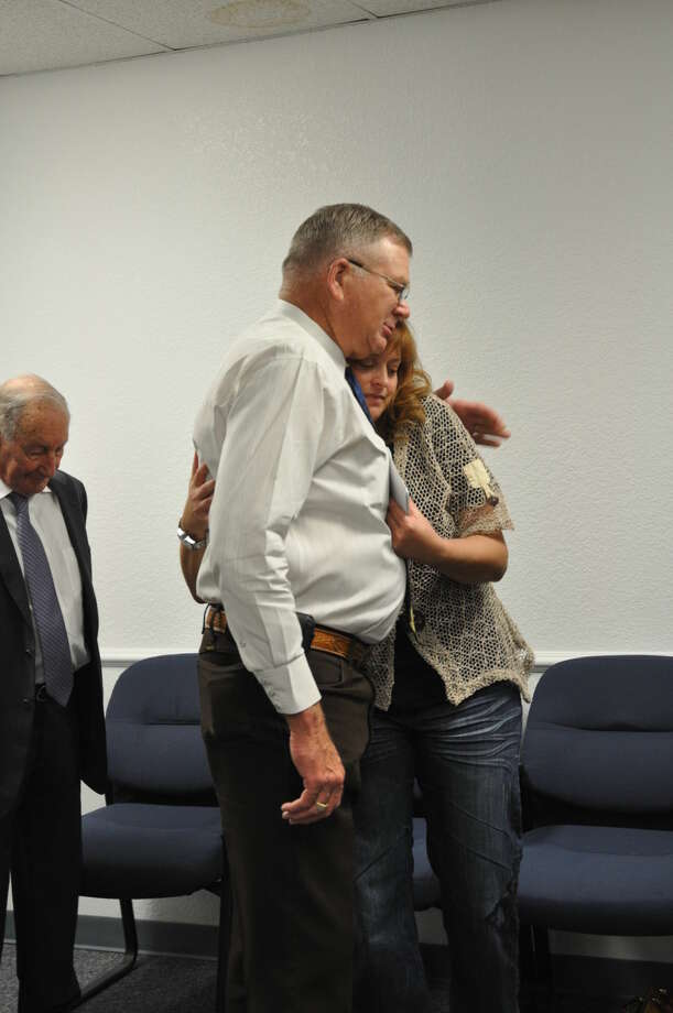 Sheriff Gary Painter hugs Denise Naylor, widow of Midland County Sheriff's Office Sgt. Mike Naylor, after a check presentation from the 200 Club Tuesday morning at the sheriff's office. Photo: Rye Druzin\Reporter-Telegram