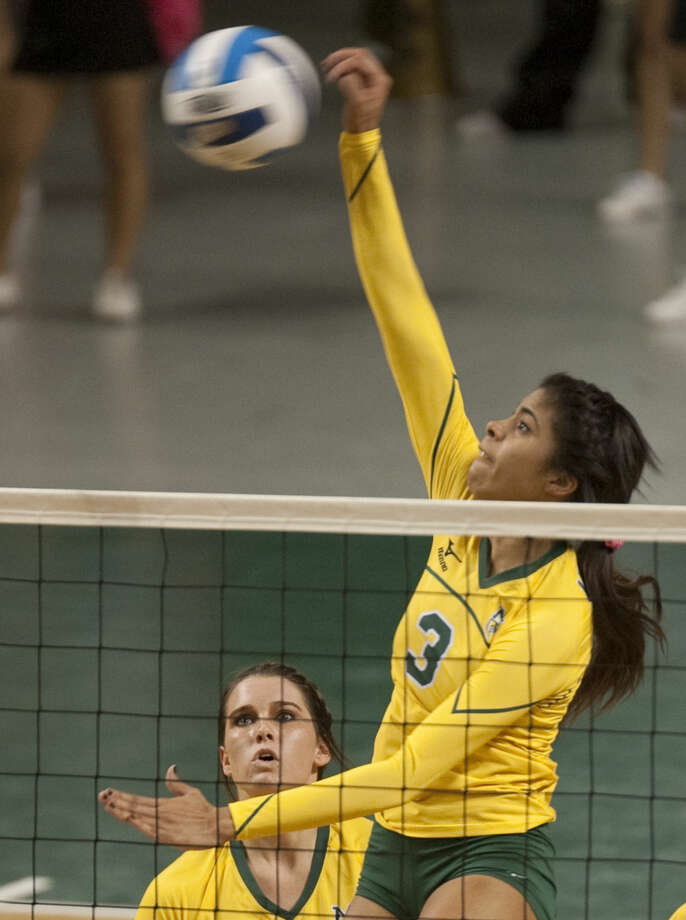 Midland College's Yahelis Villegas spikes the ball down Wednesday against Odessa College at the Chaparral Center. Tim Fischer\Reporter-Telegram Photo: Tim Fischer