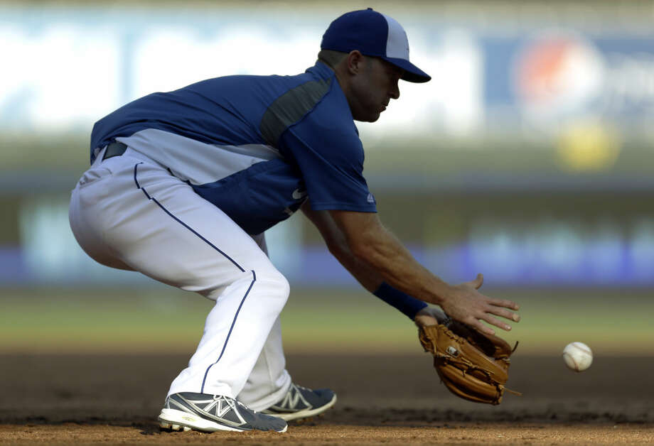 Kansas City Royals' Jayson Nix handles a ground ball during batting practice before the start of the AL wild-card playoff baseball game against the Oakland Athletics Tuesday, Sept. 30, 2014, in Kansas City, Mo. (AP Photo/Jeff Roberson) Photo: Jeff Roberson