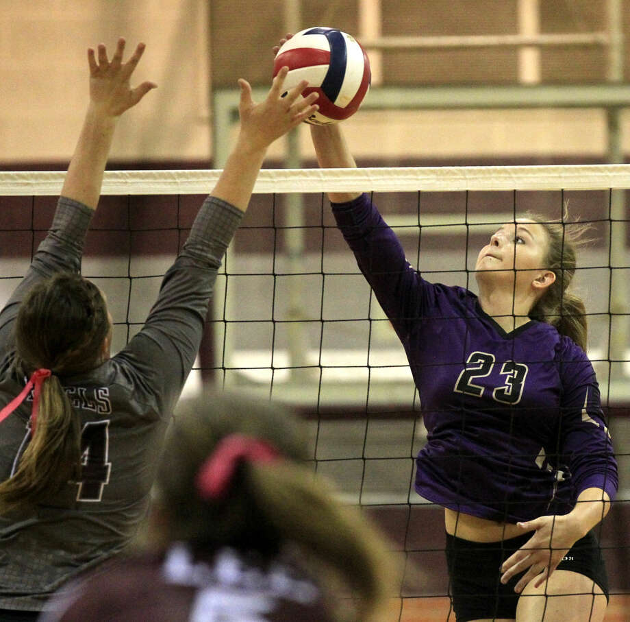 Midland High's Jenna Gillean hits against Lee High on Tuesday at Lee High. James Durbin/Reporter-Telegram Photo: James Durbin