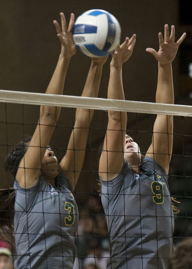 Midland College's Yahelis Villegas, 3, and Shelby Bartley, 9, go up for a bock Wednesday against New Mexico Military Institute at the Chaparral Center. Tim Fischer\Reporter-Telegram Photo: Tim Fischer