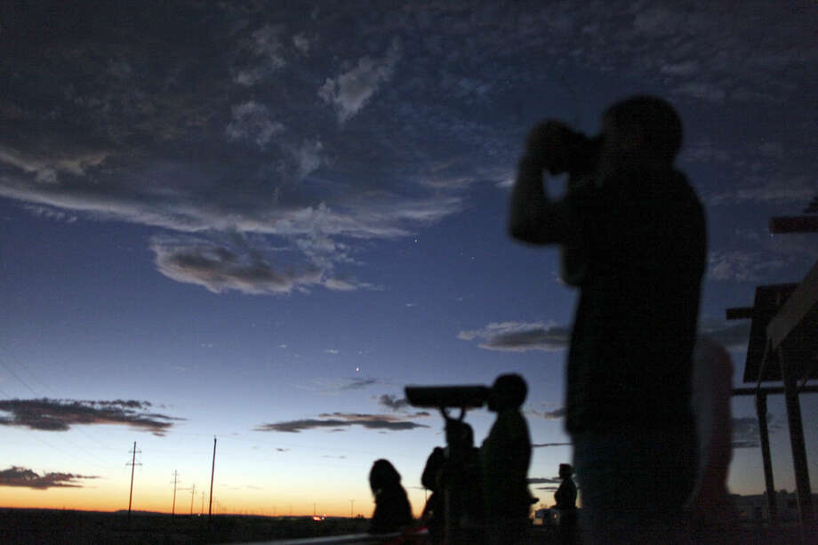 People look for the Marfa Lights on Saturday Oct. 20, 2012 at the Marfa Lights Viewing Area, nine miles east of Marfa, Tx. Photo: Edward A. Ornelas