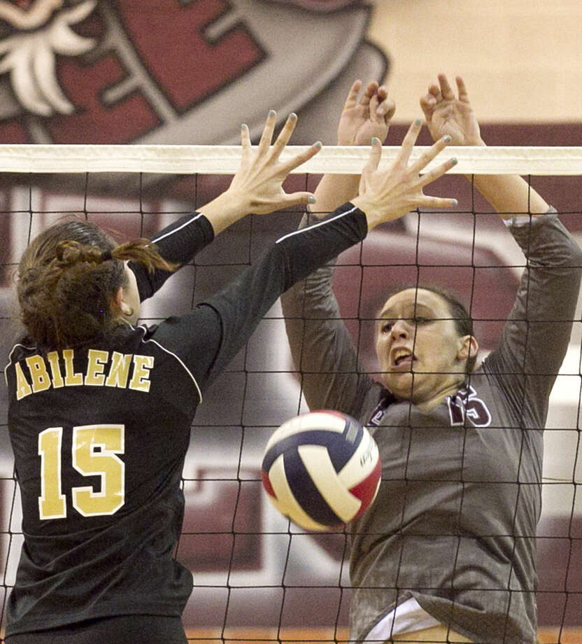 Lee High's Alissa Erdwurm tips the ball down to score against Abilene High's London Moore on Friday at Lee. James Durbin/Reporter-Telegram Photo: James Durbin