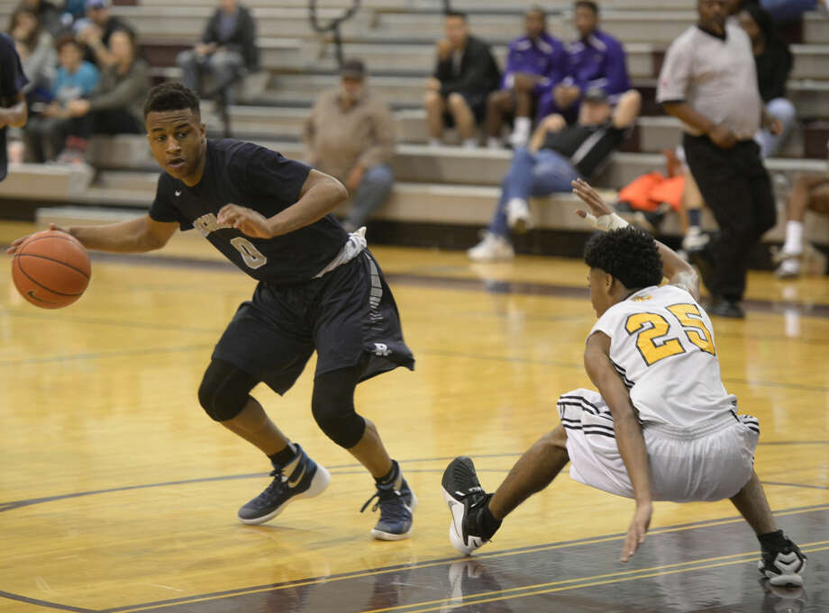 Richland's CJ Roberts makes Triple A's Michael Burks lose his footing during the Oilman's Tournament championship game on Saturday, Dec. 12, 2015 at Lee High. James Durbin/Reporter-Telegram Photo: James Durbin
