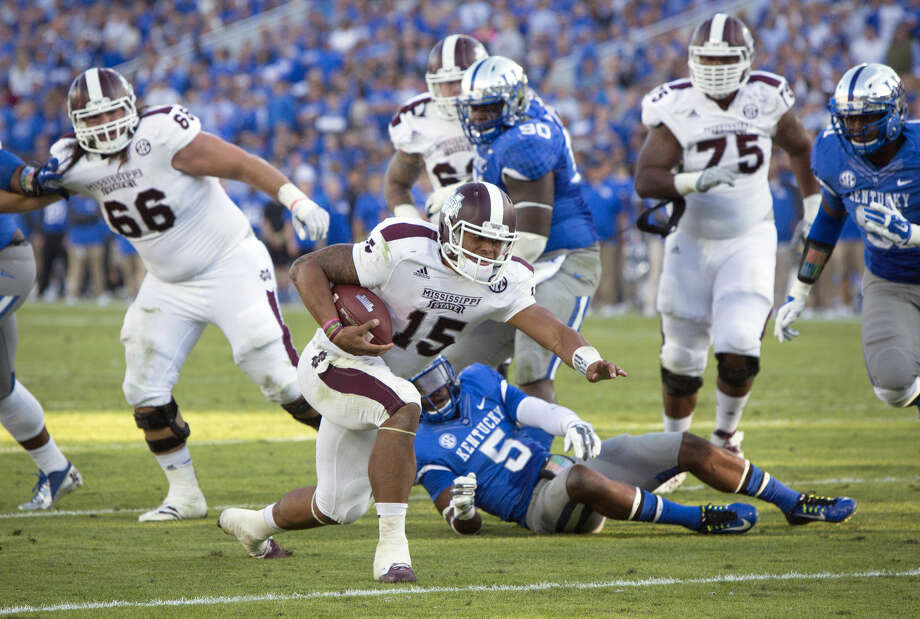 Mississippi State quarterback Dak Prescott crosses the goal line for a touchdown during the second half of an NCAA college football game against Kentucky at Commonwealth Stadium in Lexington, Ky., Saturday, Oct. 25, 2014. Mississippi State won 45-31. (AP Photo/David Stephenson) Photo: David Stephenson