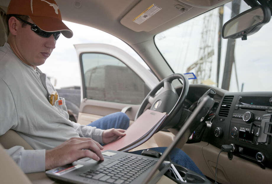 Joe Pfeil, an engineer with Devon Energy, on an active pumping rig located on Highway 385 south of Odessa, photographed Tuesday, Sept. 24, 2014. James Durbin/Reporter-Telegram Photo: James Durbin