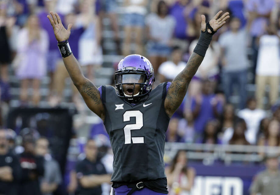TCU quarterback Trevone Boykin (2) celebrates a score against Texas Tech in the second half of an NCAA college football game, Saturday, Oct. 25, 2014, in Fort Worth, Texas. Boykin threw a school-record seven touchdown passes and No.10 TCU showcased a new fast-paced offense by scoring the most points in its history in an 82-27 rout of Texas Tech on Saturday. (AP Photo/Tony Gutierrez) Photo: Tony Gutierrez