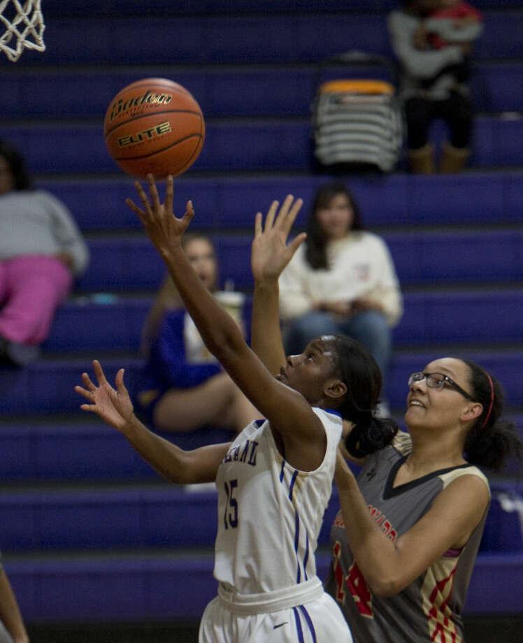 Midland High's Alexandrea Washington gets past Lubbock Coronado's Jasmine Tinnell Monday 12-14-2015 to drive to the basket at Midland High Gym. Tim Fischer\Reporter-Telegram Photo: Tim Fischer