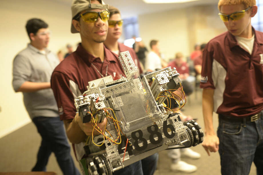 Members of the Lee High robotics team ready their robot for competition Saturday, Dec. 12, 2015, at the Petroleum Museum. Midland High School and the Texas Tech Mechanical Engineering program worked with the Petroleum Museum to host a robotics competition at the Museum. James Durbin/Reporter-Telegram Photo: James Durbin