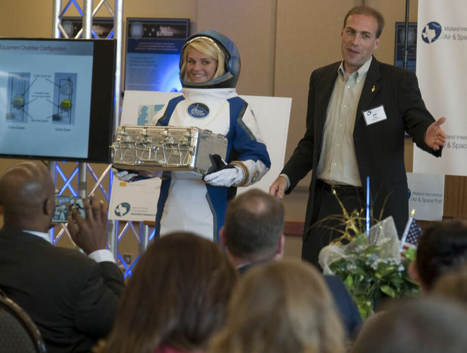 Jeff Feige CEO of Orbital Outfitters introduces LHS senior Sophie Sutter in one of their space suits Monday during a press conference at Midland International Air & Space Port. Tim Fischer\Reporter-Telegram Photo: Tim Fischer