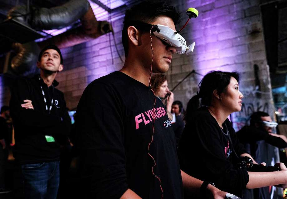 """Ken Loo, known as """"Flying Bear,"""" watches one of the drone races with other pilots in Hawthorne, Calif.  Photo: Richard Vogel, STF / Copyright 2016 The Associated Press. All rights reserved. This material may not be published, broadcast, rewritten or redistribu"""