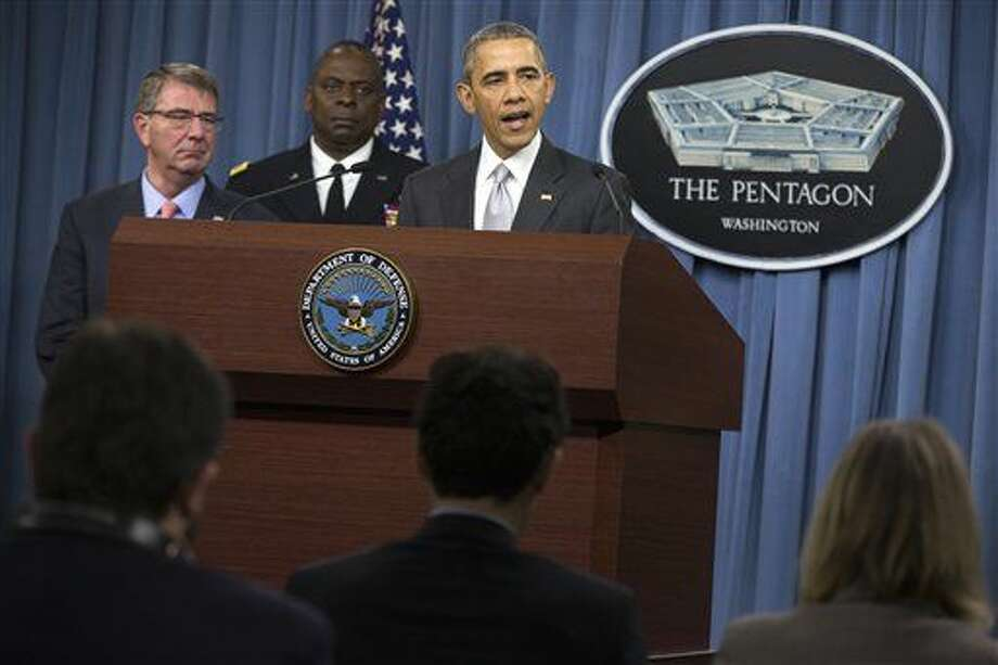 President Barack Obama, accompanied by Defense Secretary Ash Carter and Commander of U.S. Central Command Gen. Lloyd Austin, speaks at the Pentagon, Monday, Dec. 14, 2015, about the fight against the Islamic State group following a National Security Council meeting. The president said the U.S. military and allied forces are hitting the Islamic State group harder than ever. (AP Photo/Evan Vucci) Photo: Evan Vucci