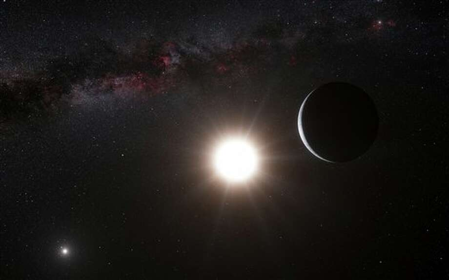 This artist's impression made available by the European Southern Observatory on Tuesday, Oct. 16, 2012 shows a planet, right, orbiting the star Alpha Centauri B, center, a member of the triple star system that is the closest to Earth. Alpha Centauri A is at left. The Earth's Sun is visible at upper right. Searching across the galaxy for interesting alien worlds, scientists made a surprising discovery: a planet remarkably similar to Earth in a solar system right next door. Other Earth-like planets have been found before, but this one is far closer than previous discoveries. Unfortunately, the planet is way too hot for life, and it's still 25 trillion miles away. (AP Photo/ESO, L. Calcada) Photo: L. Calcada / AP2012
