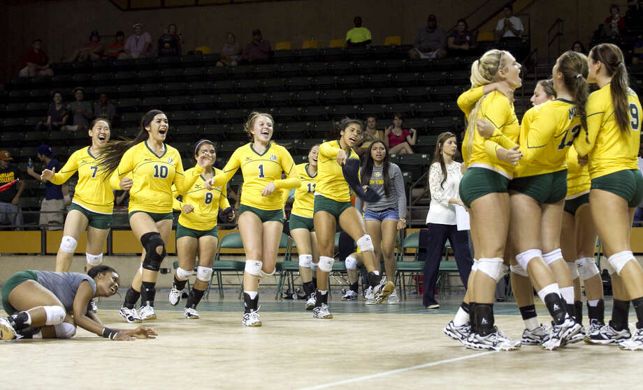 Midland College volleyball players celebrate after beating Clarendon in five games at Chaparral Center. James Durbin/Reporter-Telegram Photo: James Durbin